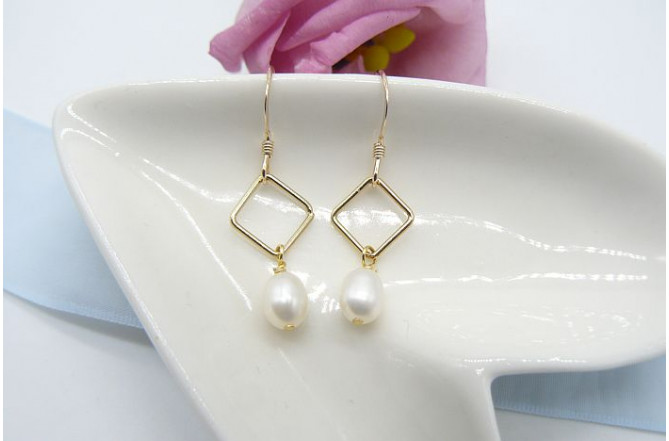 White Oval pearl on Gold Diamond Drop Earrings